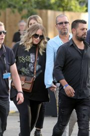 Adele - Holds Hands with a male Friend en Route to watch Celine Dion in London