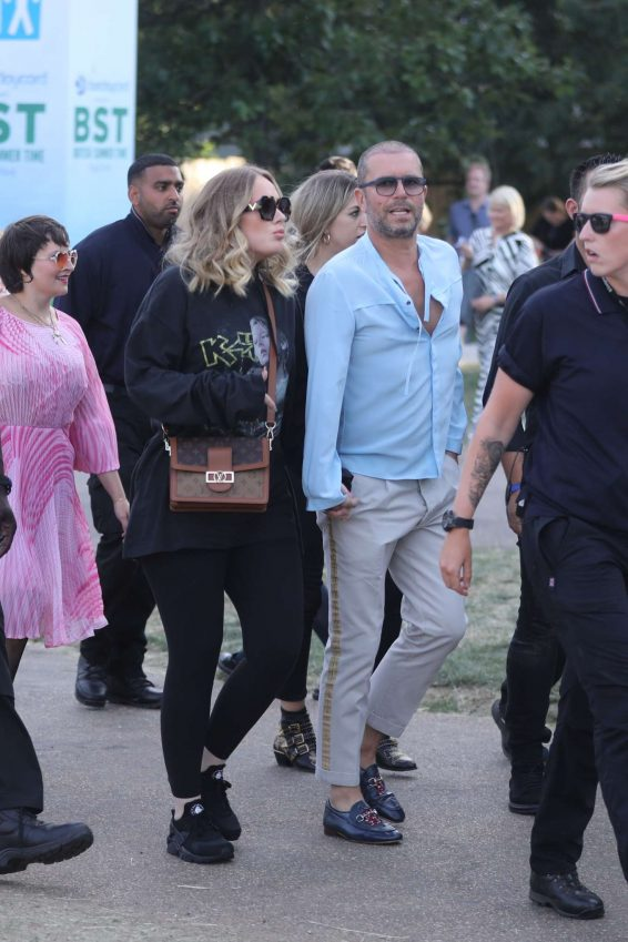 Adele – Holds Hands with a male Friend en Route to watch Celine Dion-09