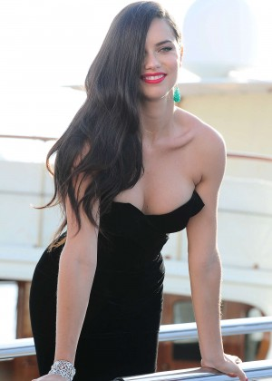 Adriana Lima in Tight Dress on a yacht in Cannes