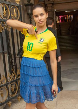 Adriana Lima in a patriotic Brazil football shirt out in Paris