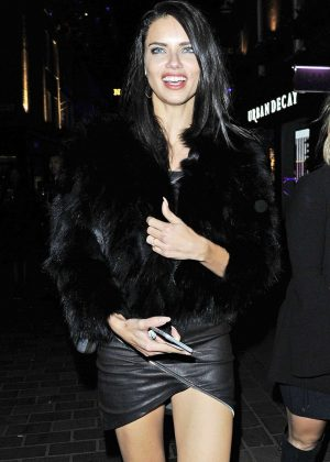 Adriana Lima in Short Leather Dress Night Out in London