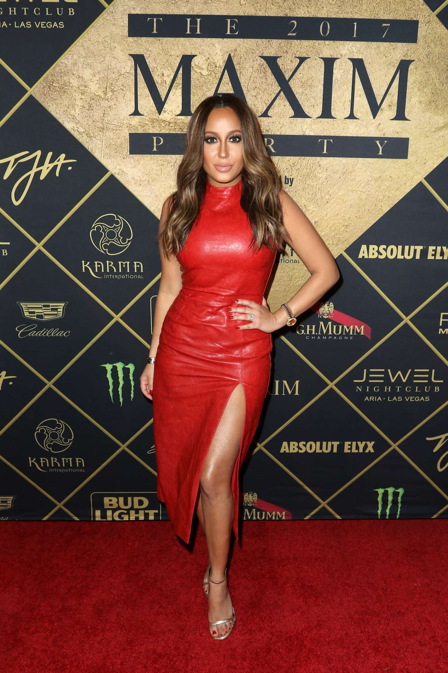 Adrienne Bailon - Maxim Super Bowl Party in Houston