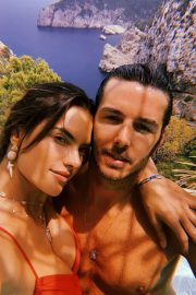 Alessandra Ambrosio and Nicolo Oddi at poolside while on their holidays in Ibiza
