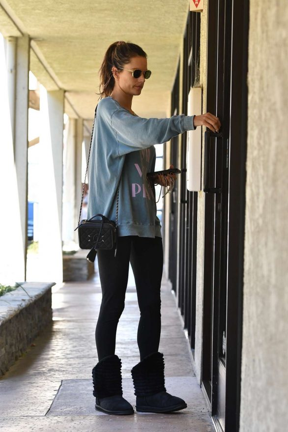 Alessandra Ambrosio - checks her phone on her way in and out of a day spa in LA