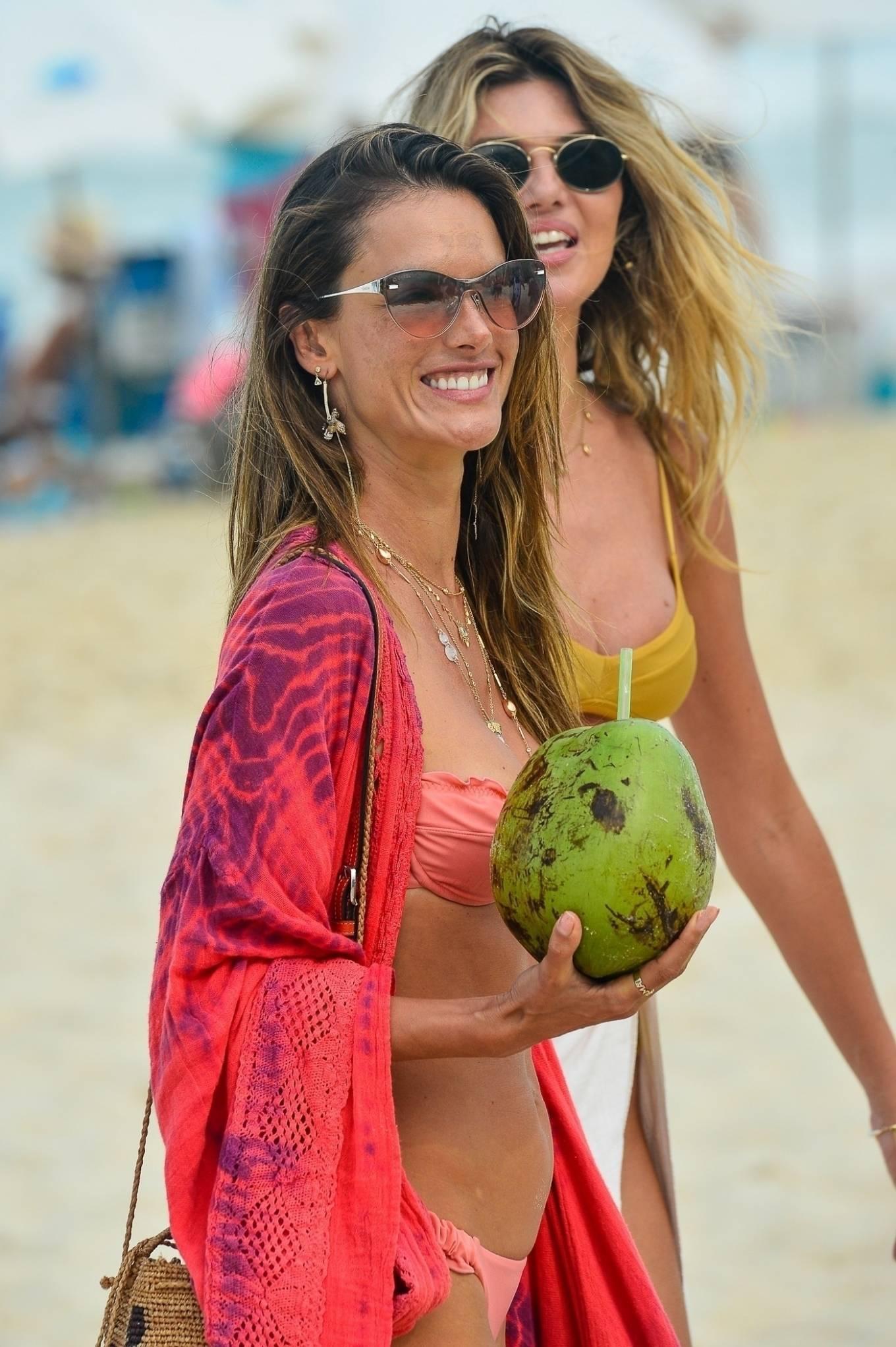 Alessandra Ambrosio - In a pink bikini on the beach in Brazil
