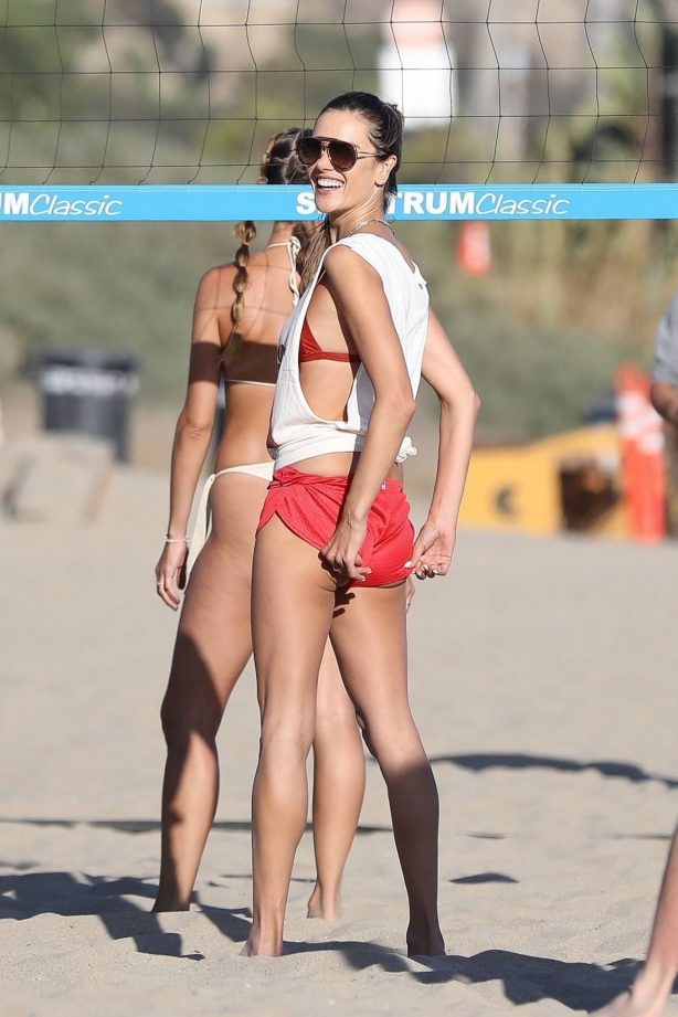 Alessandra Ambrosio - In a red bikini plays beach volley in Malibu