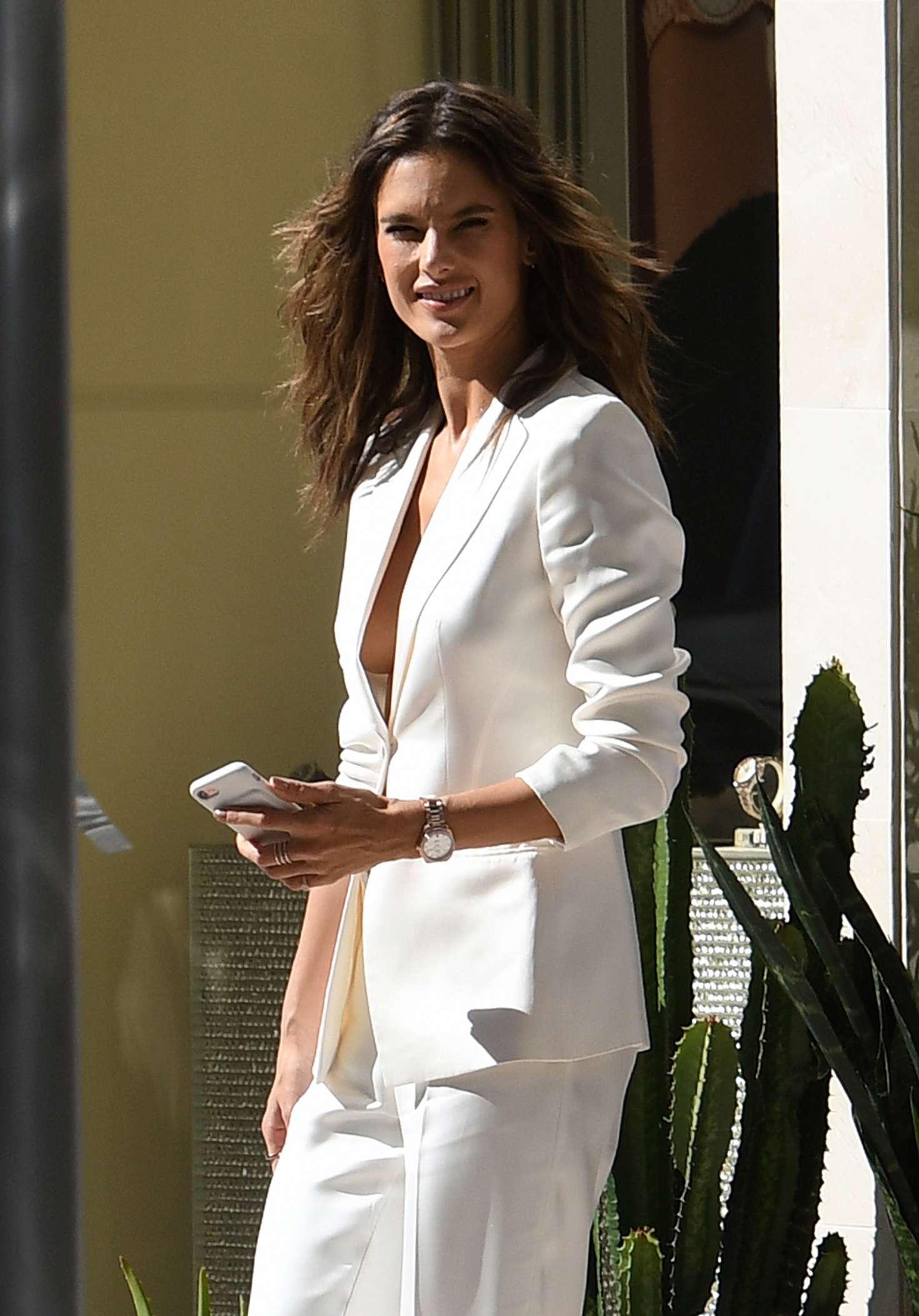 Alessandra Ambrosio in a white pantsuit in Miami