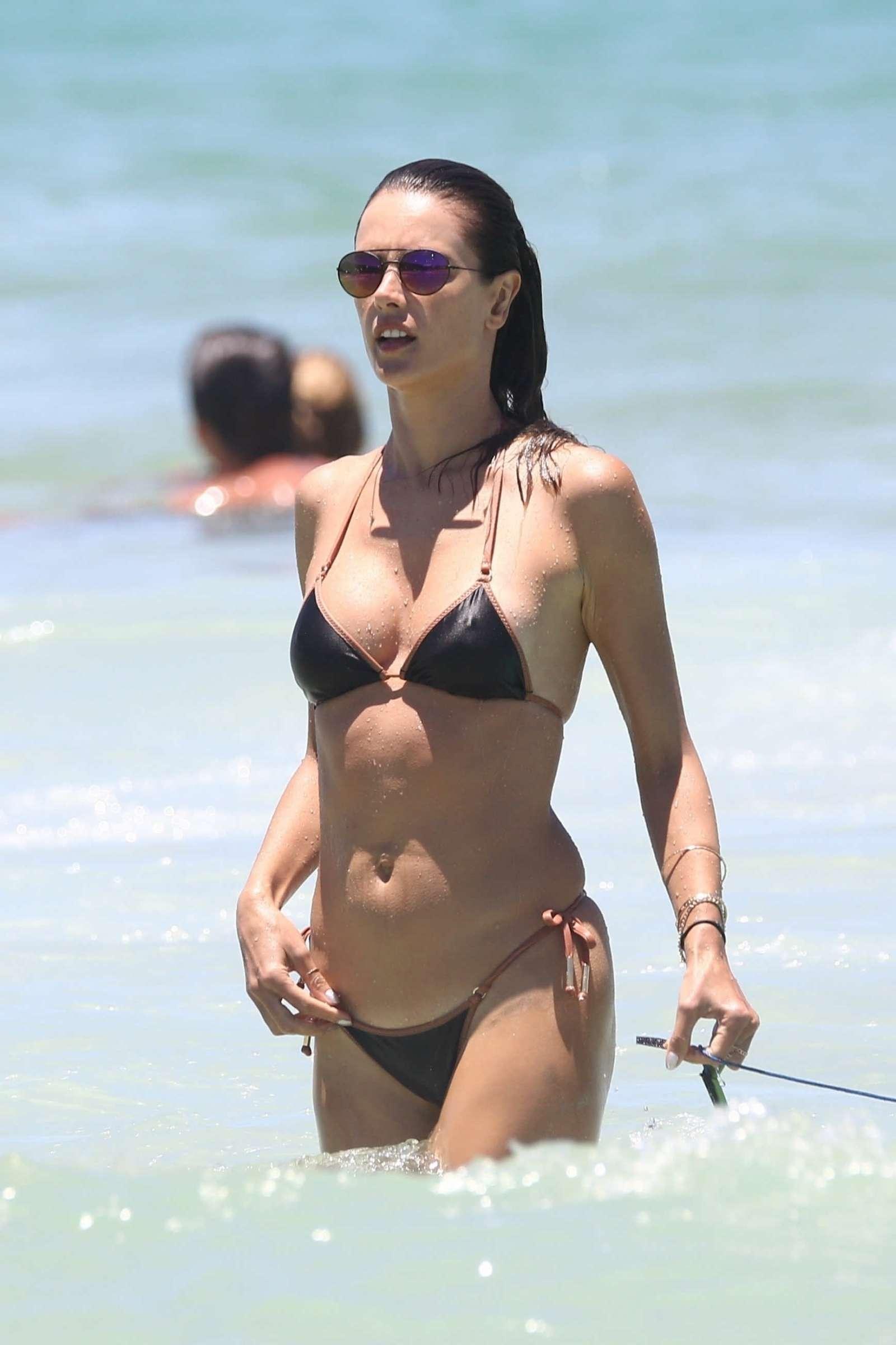 Alessandra Ambrosio in Black Bikini on the beach in Brazil