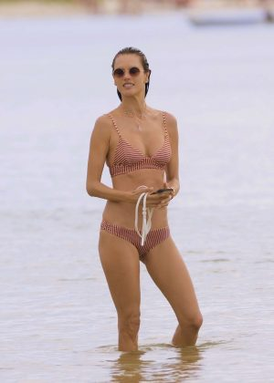 Alessandra Ambrosio in Red and White Bikini at a beach in Brazil
