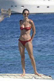 Alessandra Ambrosio in Red Bikini at the beach in Mykonos