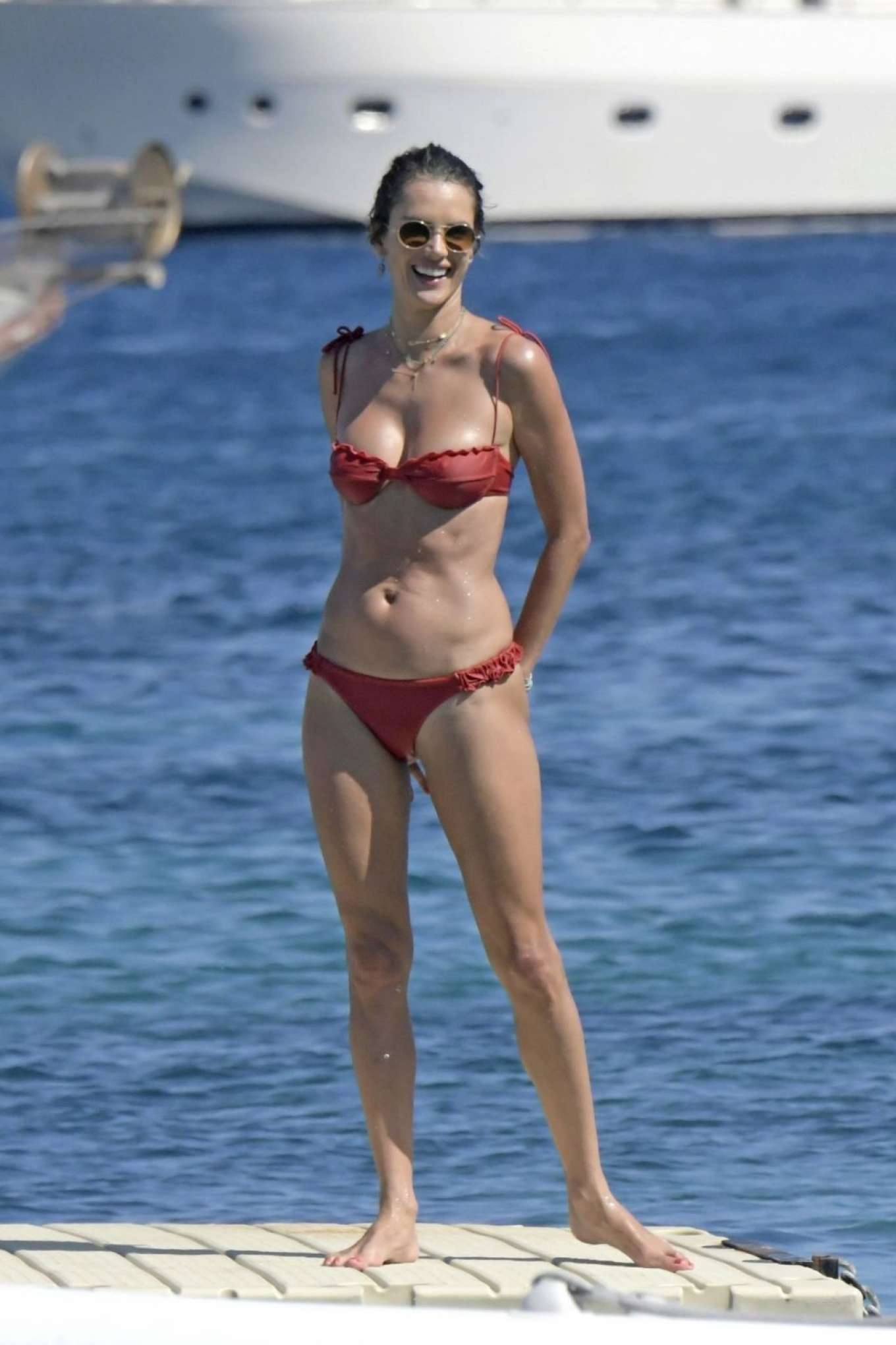 Alessandra Ambrosio in Red Bikini at the beach in Mykonos