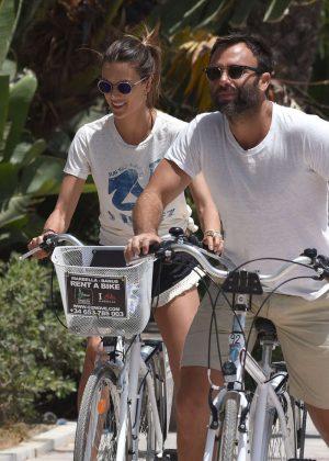 Alessandra Ambrosio in Shorts Riding Bikes -02