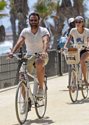 Alessandra Ambrosio in Shorts Riding Bikes -04