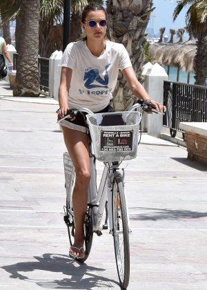 Alessandra Ambrosio in Shorts Riding Bikes -09