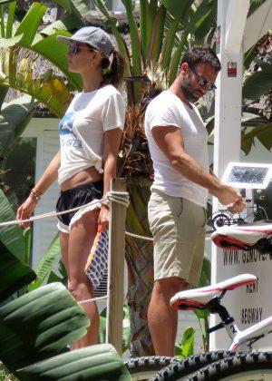 Alessandra Ambrosio in Shorts Riding Bikes -17