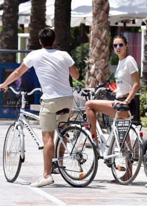 Alessandra Ambrosio in Shorts Riding Bikes -21