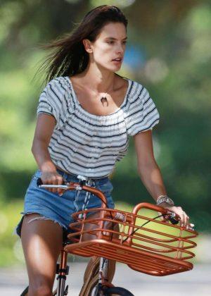 Alessandra Ambrosio in Shorts riding her bike in LA