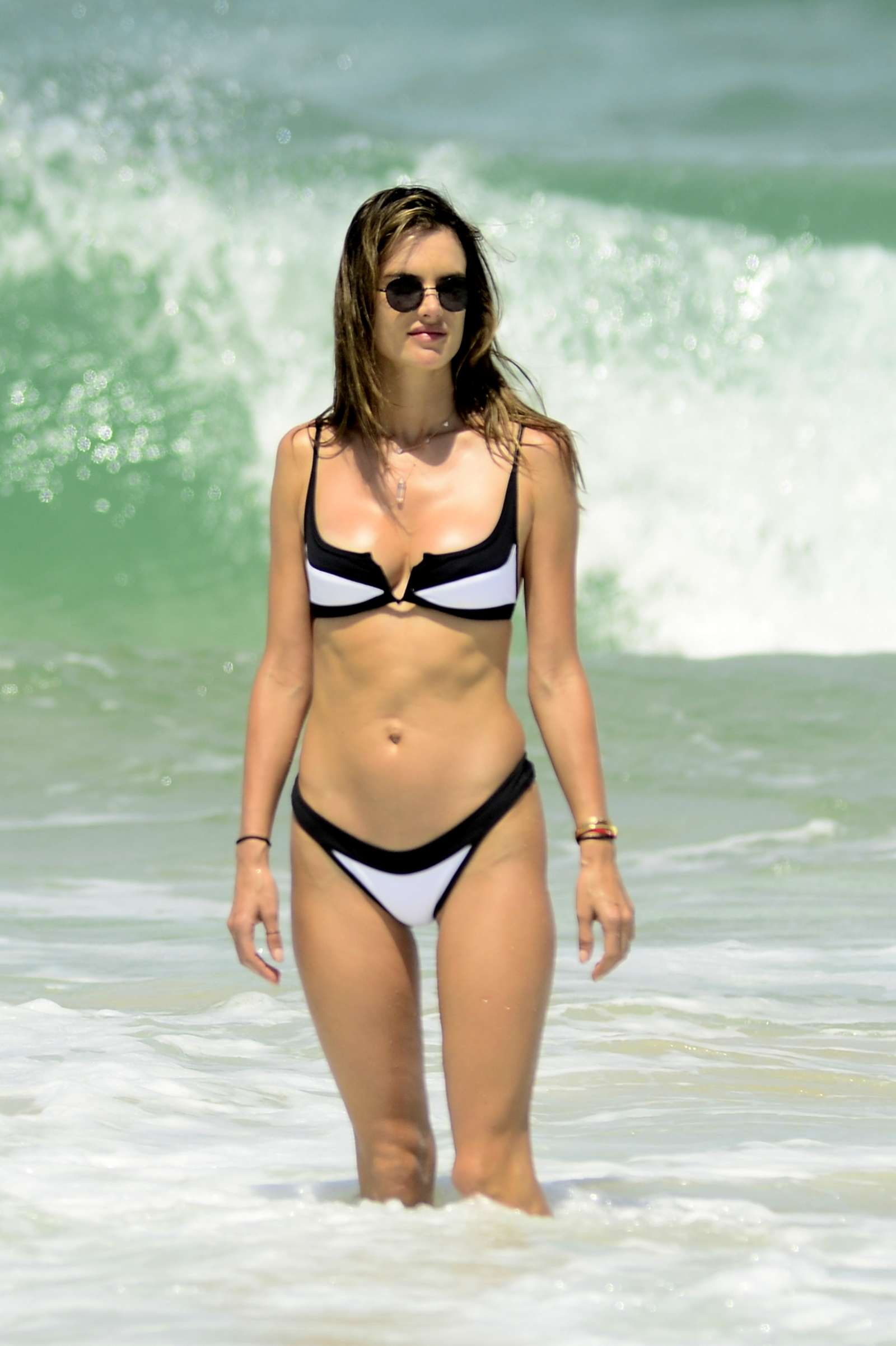 Alessandra Ambrosio in White and Black Bikini on the beach in Florianopolis