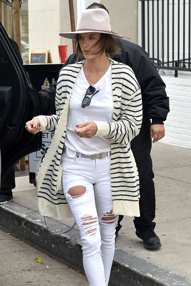 Alessandra Ambrosio in white ripped jeans out in West Hollywood