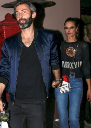 Alessandra Ambrosio with a mystery guy leaving the Moschino afterparty in Hollywood