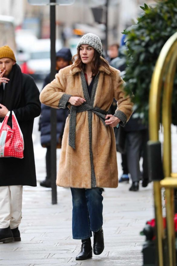 Alexa Chung remains bundled up in Paris
