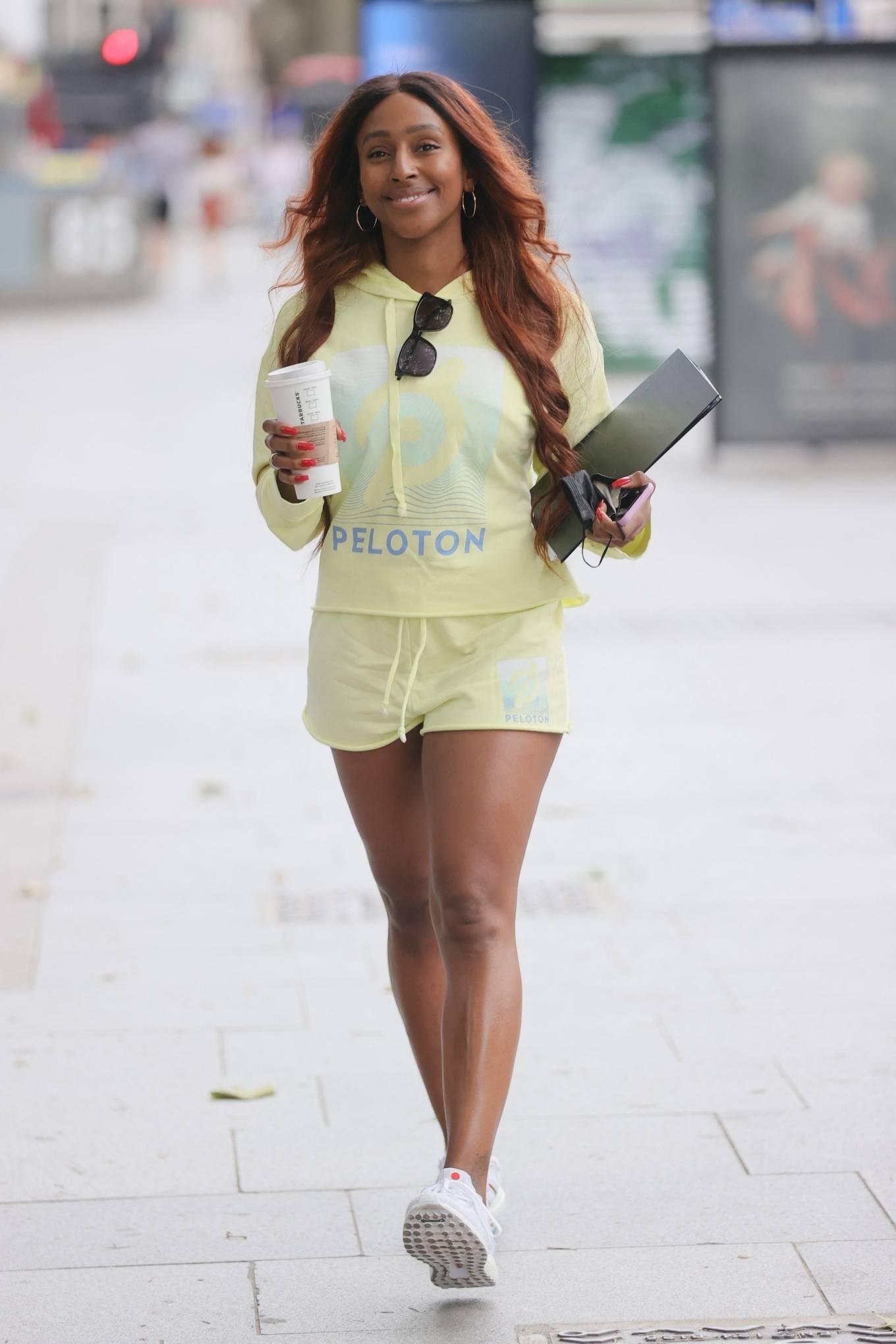 Alexandra Burke 2021 : Alexandra Burke – Wearing a yellow top and shorts in London-05