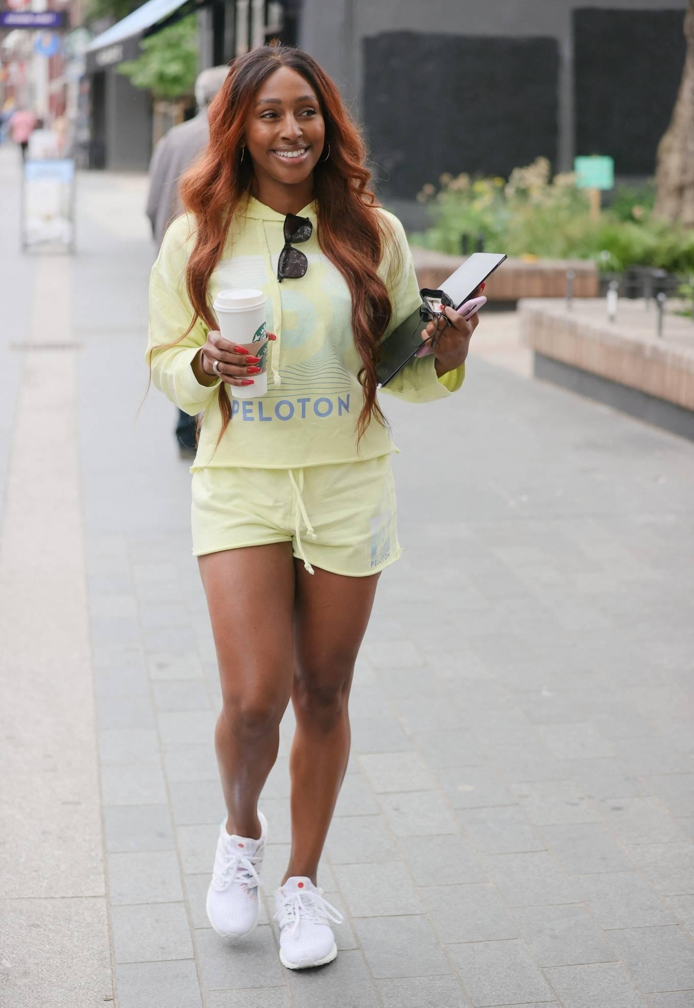 Alexandra Burke 2021 : Alexandra Burke – Wearing a yellow top and shorts in London-10