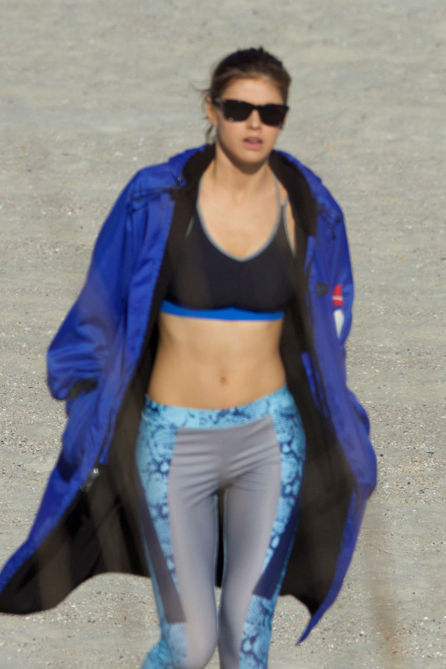 Alexandra Daddario in Tights and Sports Bra on the set of 'Baywatch' in Tybee