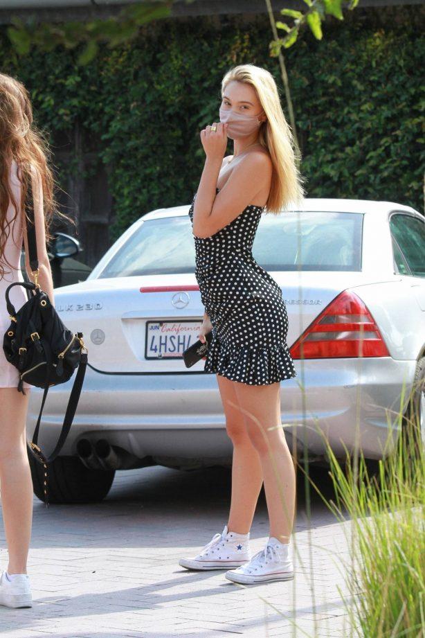 Alexis Ren - In black mini in Malibu