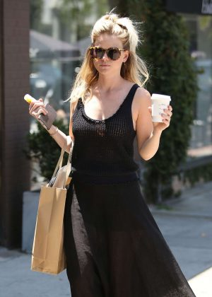 Alice Eve in black dress shopping on Melrose Place in West Hollywood