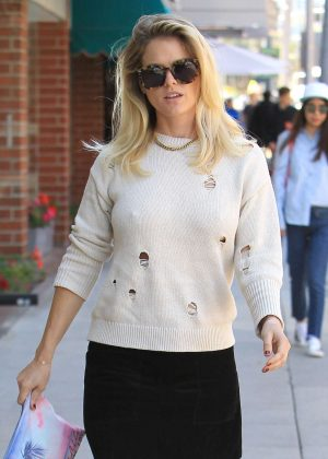 Alice Eve in Black Mini Skirt at a nail salon in Beverly Hills