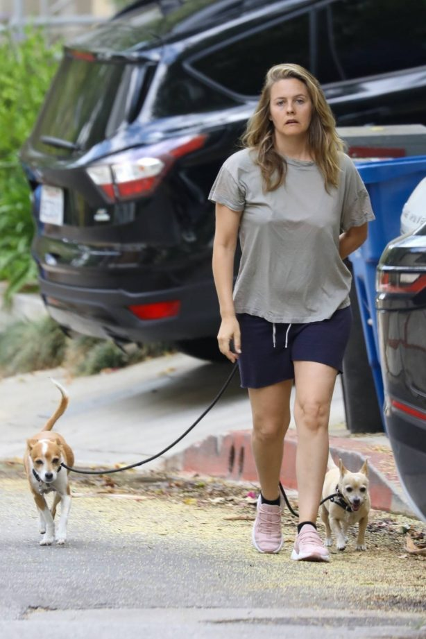 Alicia Silverstone - Walking her dogs in Los Angeles