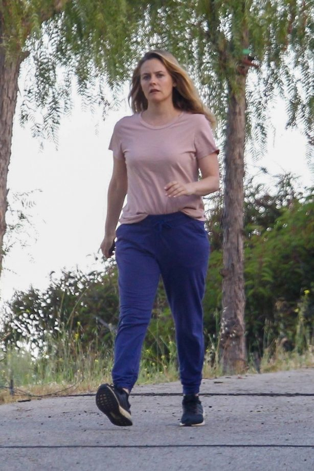 Alicia Silverstone - Walks her dogs with her boyfriend in Beverly Hills