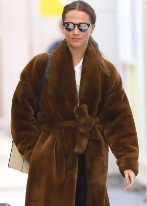 Alicia Vikander in Fur Coat - Arrives at JFK airport in NYC