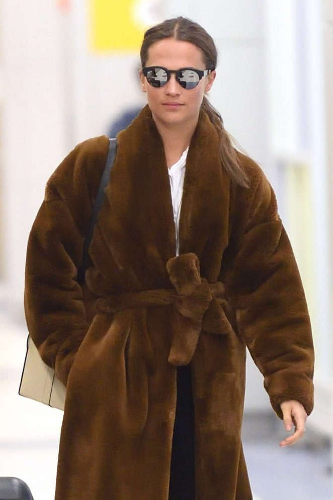 Alicia Vikander in Fur Coat - Arrives at JFK airport in NYC