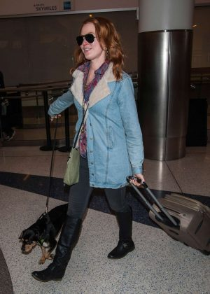 Alicia Witt with her dog at LAX airport in Los Angeles
