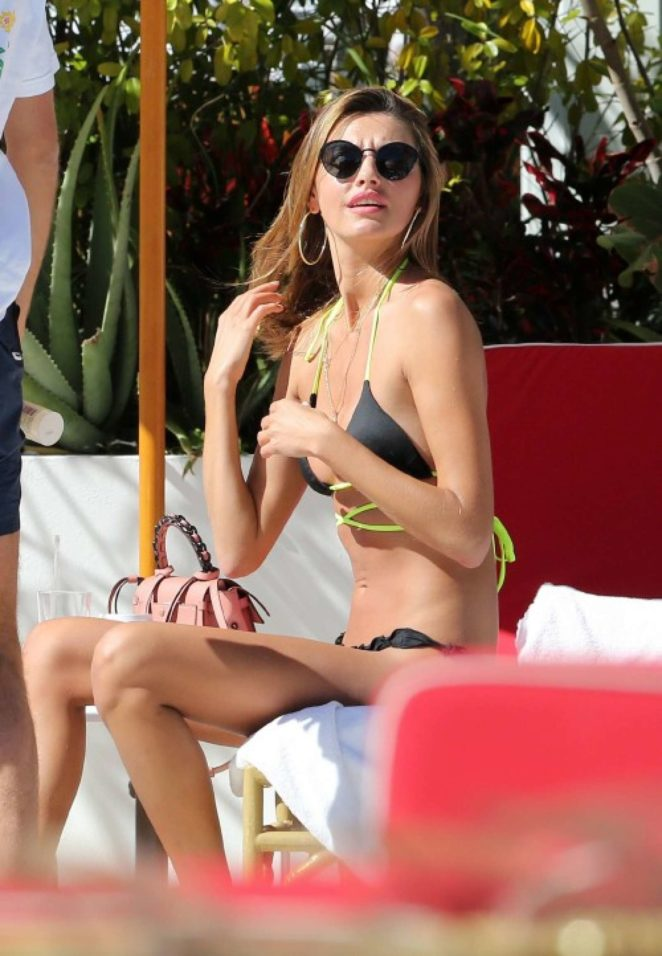 Alina Baikova in Bikini - Sunbathes by the pool in Miami