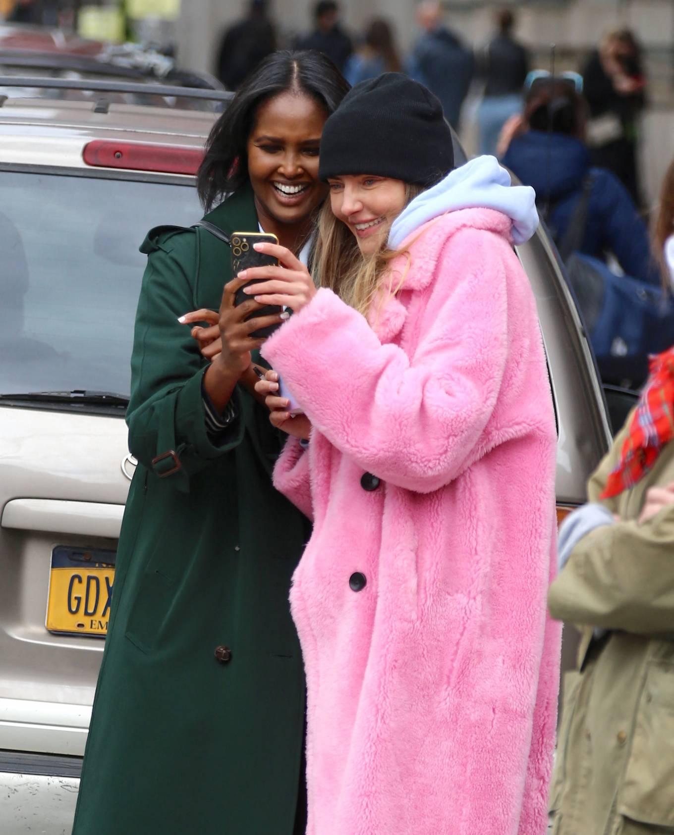 Alina Baikova - With Ubah Hassan doing live social media video on the street in Soho - New York