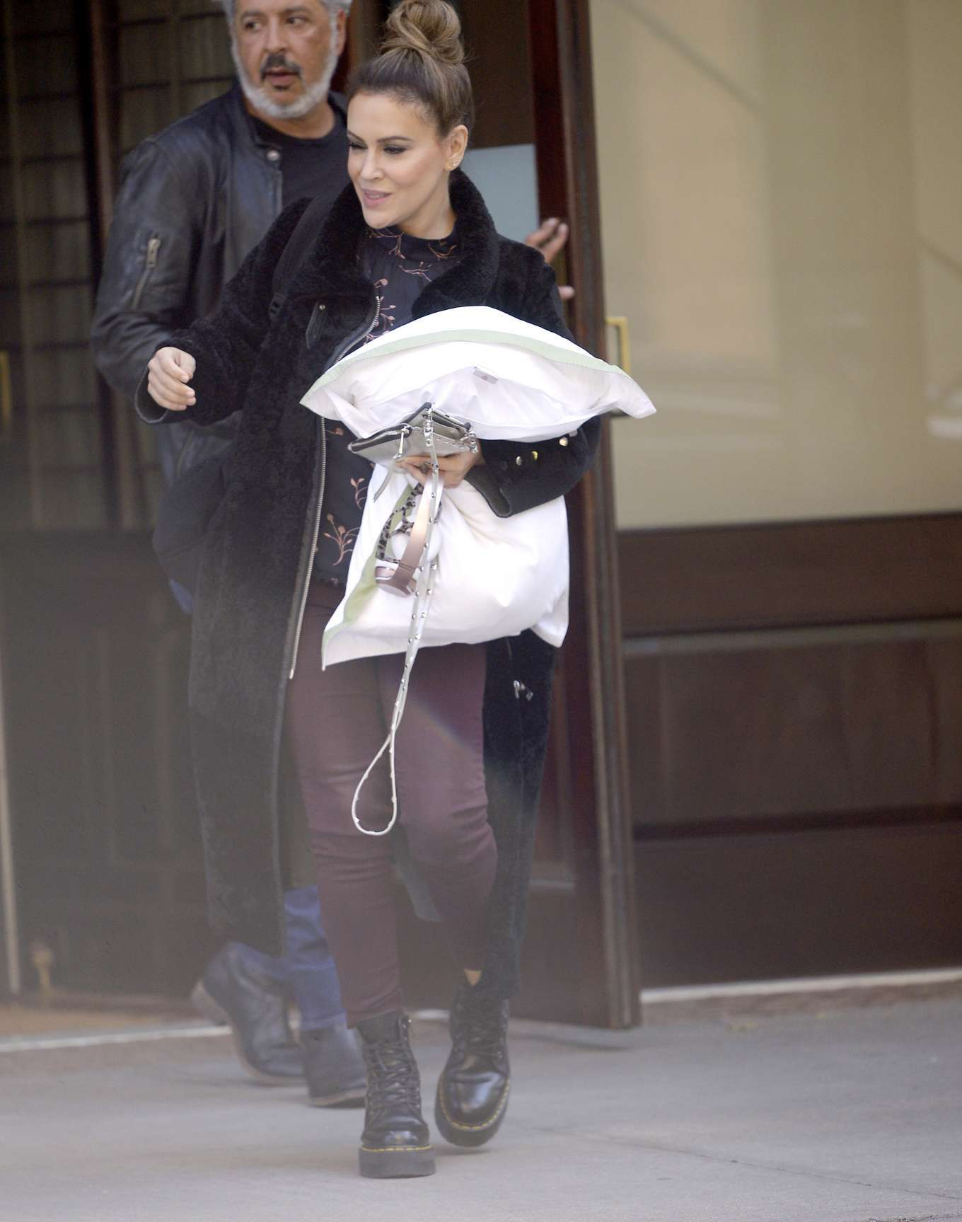 Alyssa Milano - Leaves her hotel with pillow in New York City