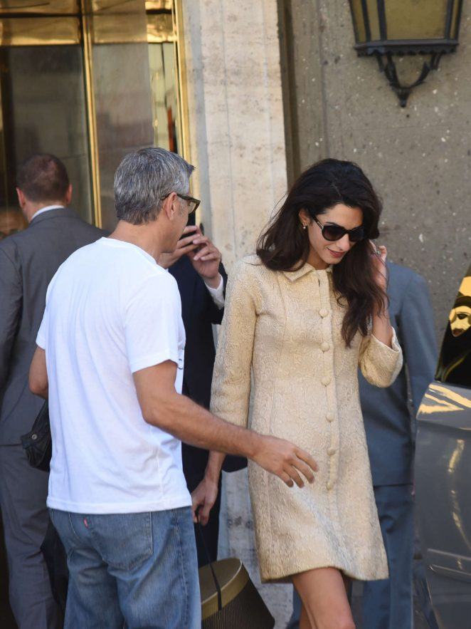 Amal and George Clooney leaving her hotel in Rome