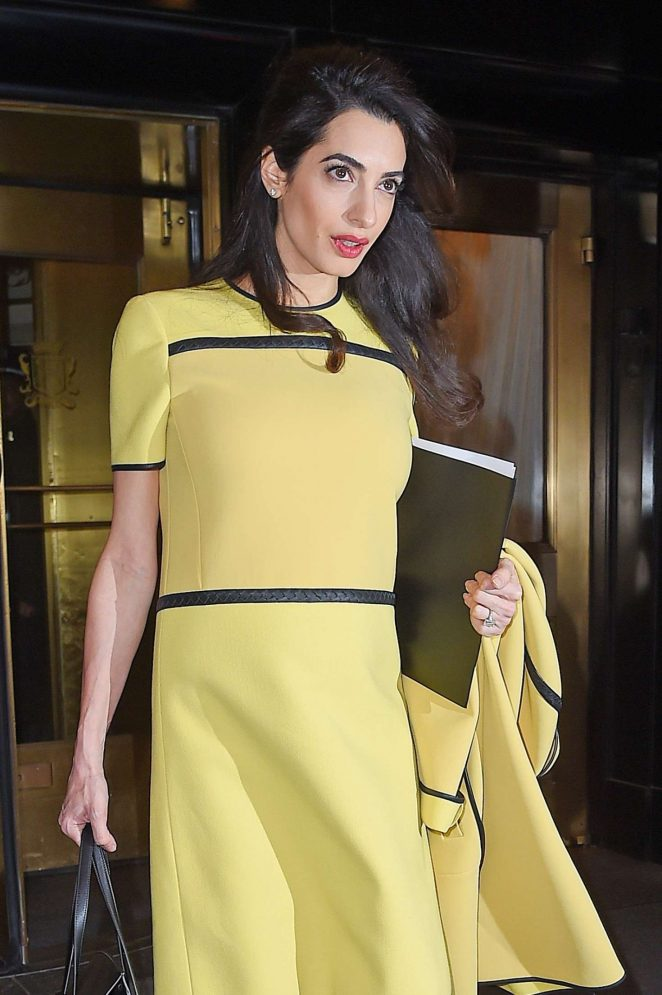 Amal Clooney in bright yellow leaves her hotel in NY
