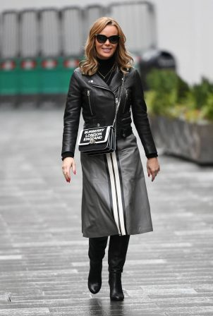 Amanda Holden - In a Sosandar skirt and Dune London Boots in London