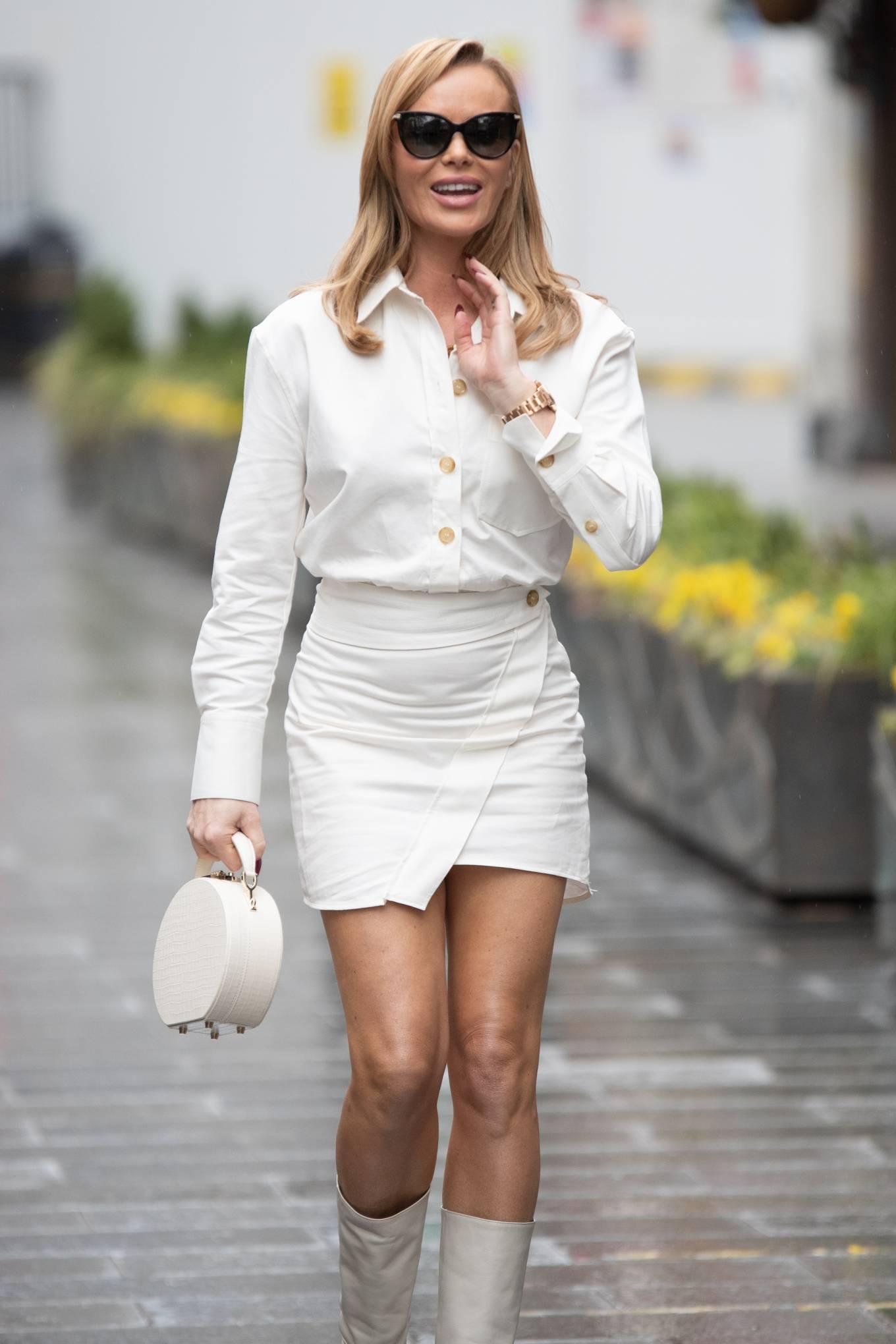 Amanda Holden - In a white miniskirt at Heart Radio Studio in London