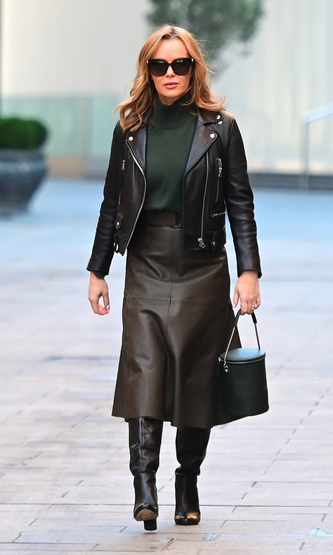 Amanda Holden - In leather skirt and knee high boots at Heart radio in London