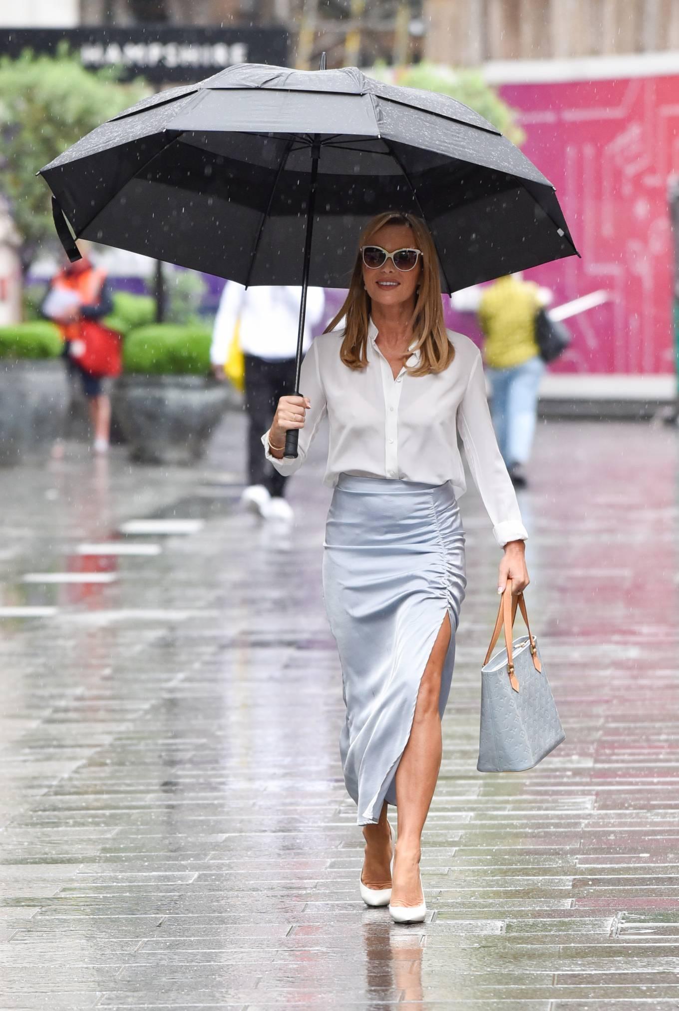 Amanda Holden - In light blue split skirt leaves Global radio in London