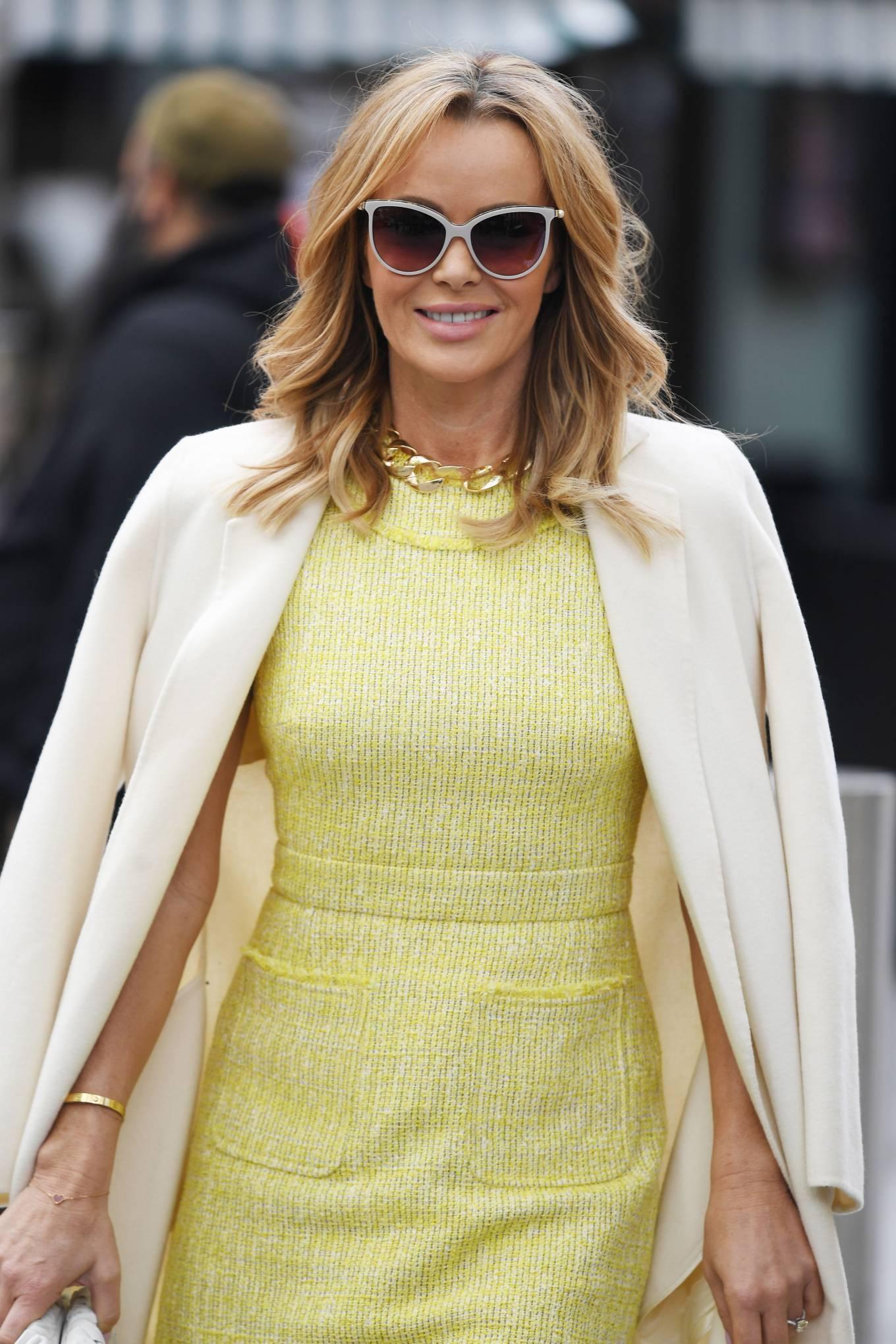 Amanda Holden 2021 : Amanda Holden – In yellow dress and a cream long coat at Heart radio London-01