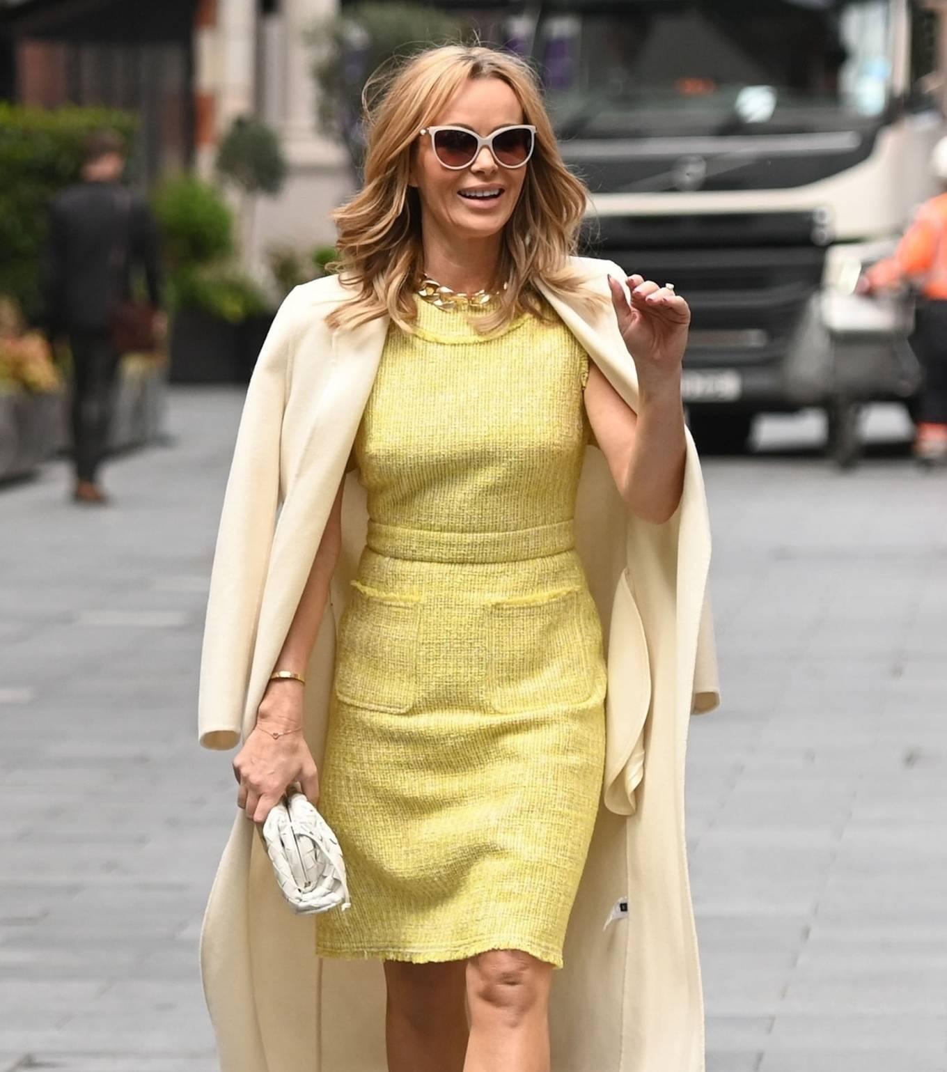 Amanda Holden 2021 : Amanda Holden – In yellow dress and a cream long coat at Heart radio London-02