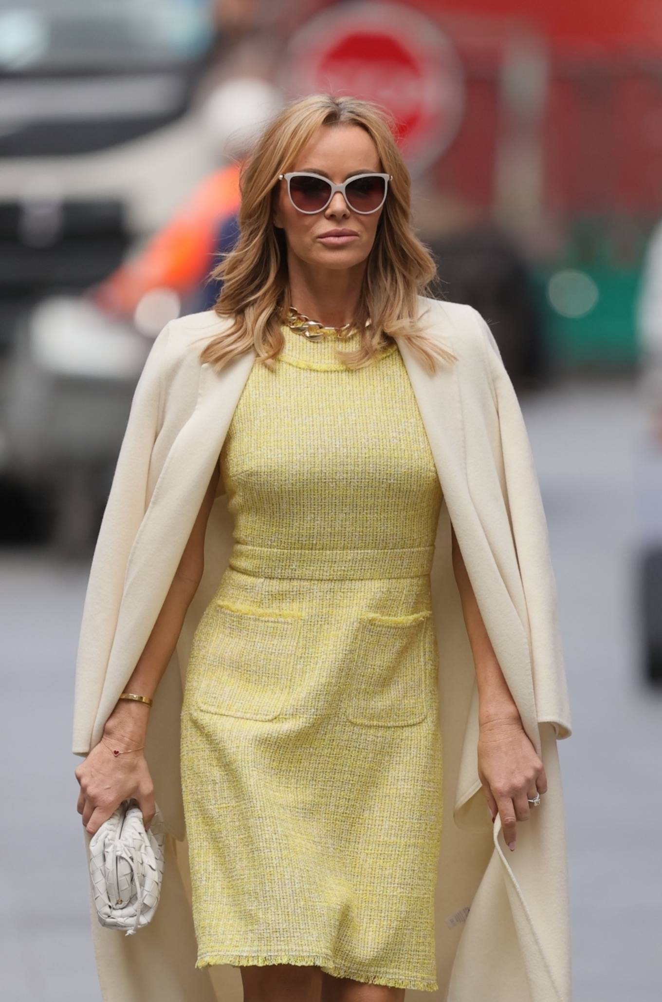 Amanda Holden 2021 : Amanda Holden – In yellow dress and a cream long coat at Heart radio London-03