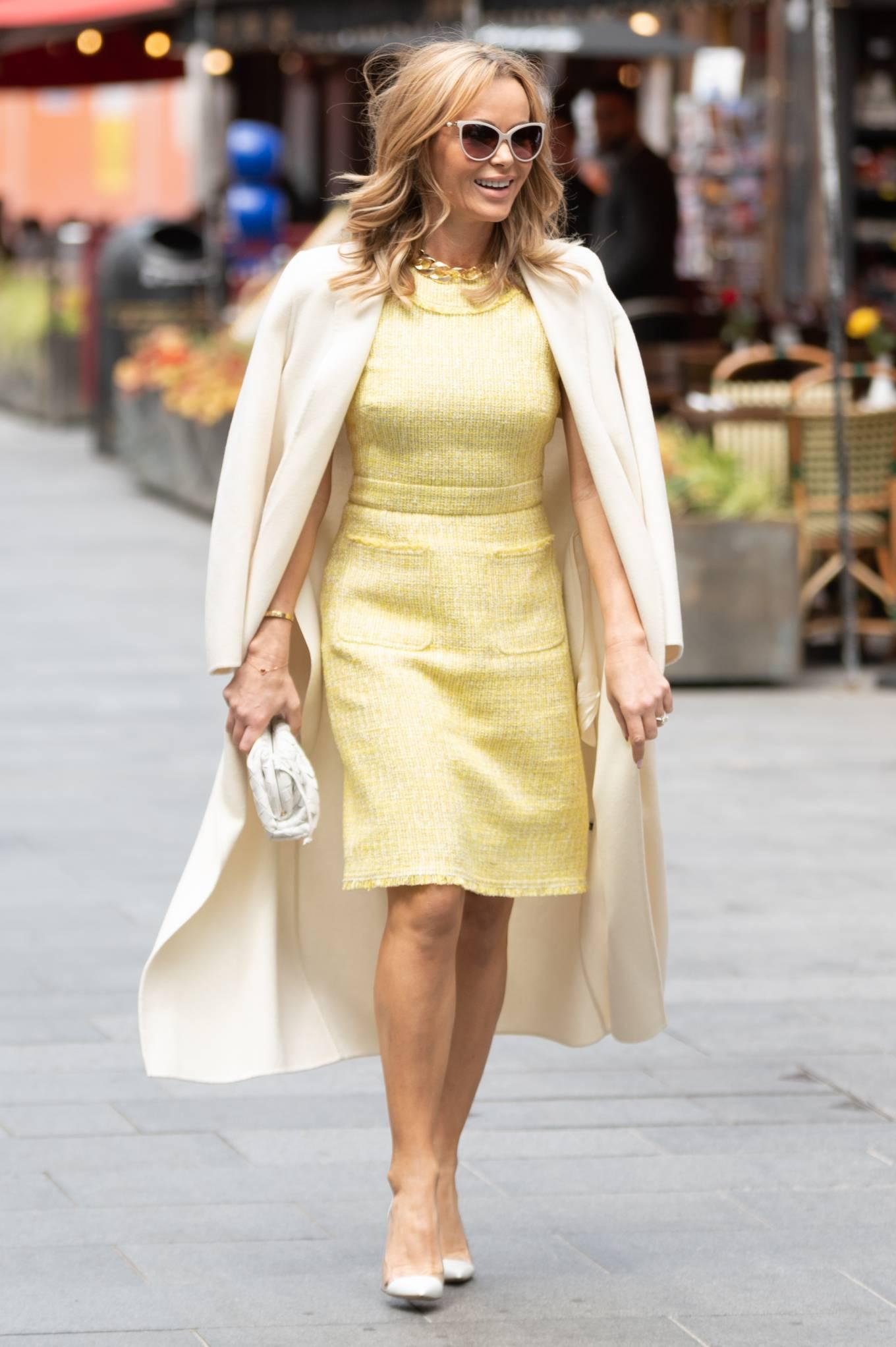 Amanda Holden 2021 : Amanda Holden – In yellow dress and a cream long coat at Heart radio London-05