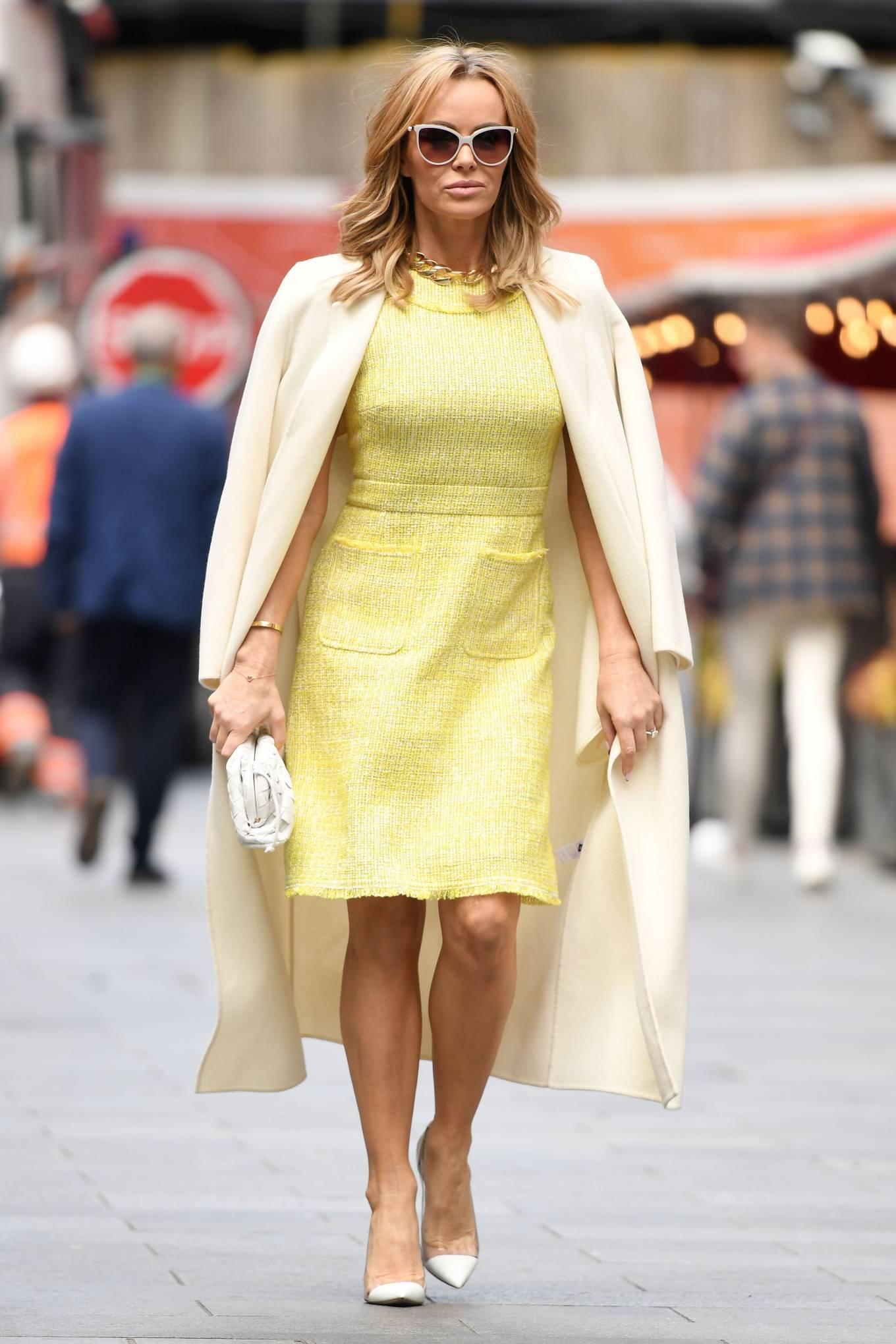 Amanda Holden 2021 : Amanda Holden – In yellow dress and a cream long coat at Heart radio London-07